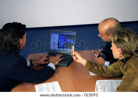 Meeting with a laptop - stock photo