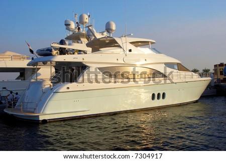 Mega big white yacht on a sunset - stock photo