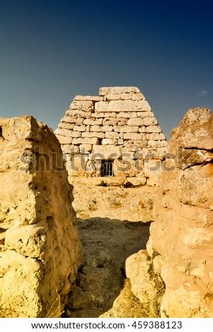 Megalithic Minorca. Naveta des Tudons - prehistoric sacral pyramid near Ciutadella town. - stock photo