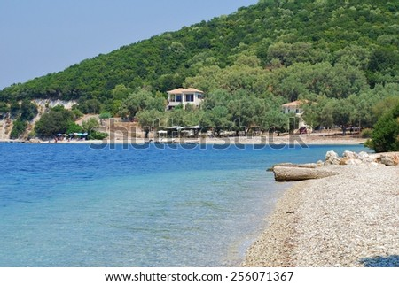 MEGANISSI, GREECE - AUGUST 24, 2008: The shingle beach at Agios Ioannis on the Greek island of Meganissi. With a population of around 2000, the Ionian island is a satellite of larger Lefkada island. - stock photo