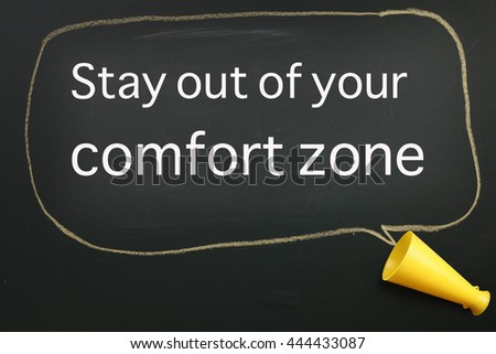 megaphone and speech bubble with text stay out from your comfort zone - stock photo