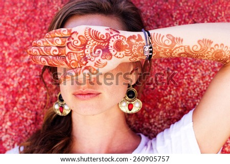 Mehendi art or Heena Tattoo on the hand of beautiful girl, India - stock photo