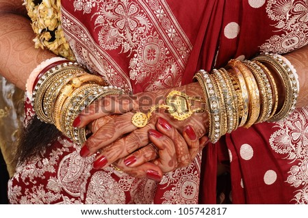 Mehndi, application of henna as skin decoration in Indian Wedding. - stock photo