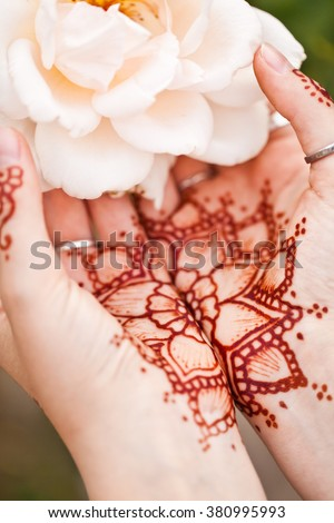 Mehndi tattoo. Woman Hands with black henna tattoos. India national traditions - stock photo
