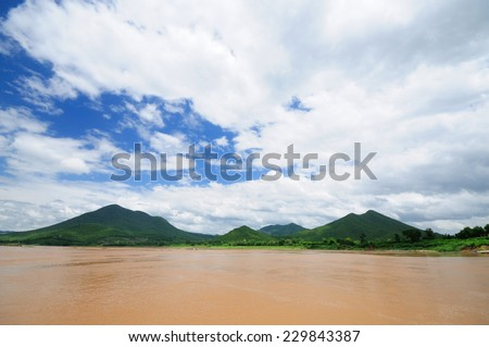 Mekong riverside mountain Laos. scenery of Mekong river, boundary of Thailand and Lao People's Democratic Republic. - stock photo
