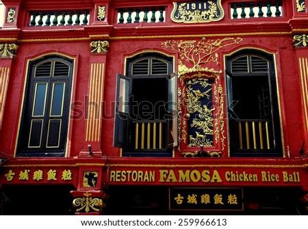 Melaka, Malaysia - December 27, 2007: Gilded facade of 1911 Chinese building housing famed Famosa Chicken Rice Ball Restaurant on Jonker Walk - stock photo