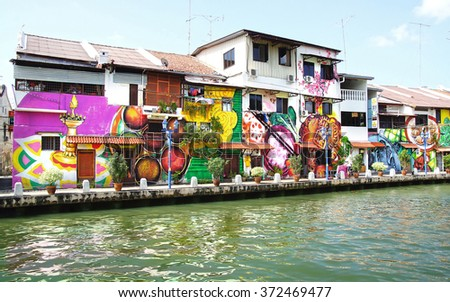 MELAKA, MALAYSIA -JANUARY 29,2014: Street art on buildings along the Melaka river. Malacca, dubbed Historic State historical city centre has been listed as UNESCO World Heritage Site since 7 /8/ 2008. - stock photo