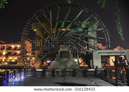 Melaka, Malaysia - September 22 2015: The Ancient Wooden Water Wheel near the Melaka River - stock photo