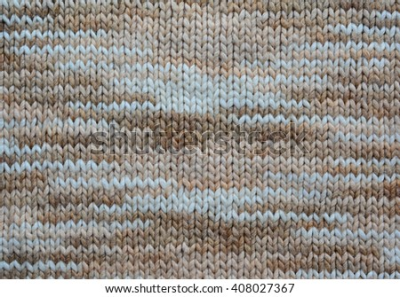 Melange wool knitting.  Textile background. Old knit - stock photo