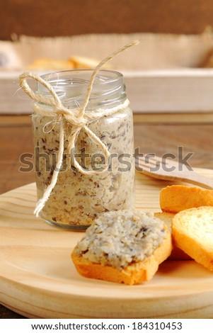 Melba toasts with homemade mushroom pate - stock photo
