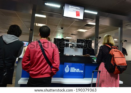 MELBOURNE - APR 15 2014:Passengers at Australian Customs and Border Protection checkpoint in Melbourne airport.The agency responsible for the safety, security and commercial interests of Australians - stock photo