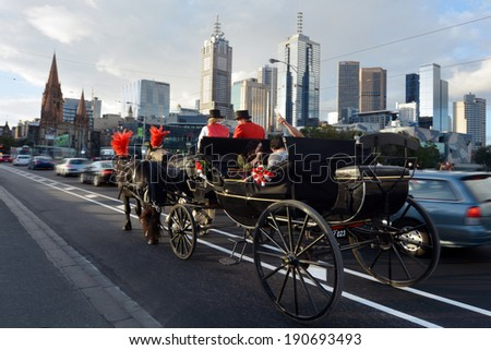 MELBOURNE - APR 13, 2014:Traffic under Melbourne skyline Victoria, Australia.Melbourne have population and employment growth with international investment in the city's industries and property market. - stock photo
