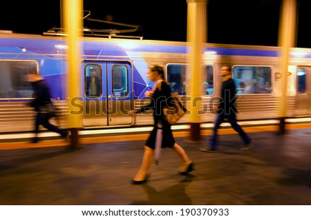 MELBOURNE, AUS - APR 11 2014:Metro Trains Melbourne passengers.It travels over 30 million Km and service more than 228 million customers a year and carries over 415,000 passengers each weekday. - stock photo