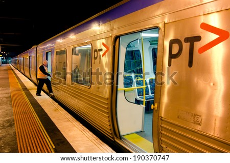 MELBOURNE, AUS - APR 11 2014:Metro Trains Melbourne security .It travels over 30 million Km and service more than 228 million customers a year and carries over 415,000 passengers each weekday. - stock photo