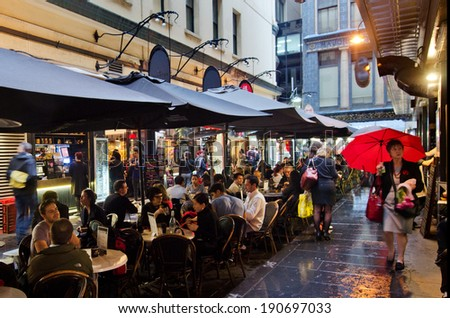 MELBOURNE, AUS - APR 10 2014:Traffic on Degraves Street, one of Melbourne's finest Laneway environments. Full of bars,restaurants, cafe and boutique shopping. - stock photo