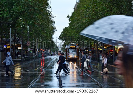 MELBOURNE, AUS - APR 11 2014:Traffic on Swanston Street.Since the 90s Melbourne have population and employment growth with international investment in the city's industries and property market. - stock photo