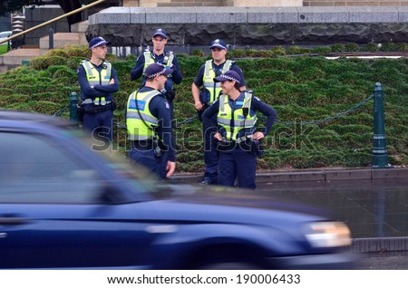 MELBOURNE, AUS - APR 14 2014:Victoria Policemen.As of 2013, Victoria Police has over 12,539 sworn members across 325 police stations.It has a running cost of aprox. 2.1b $AUD (A$372 per resident). - stock photo