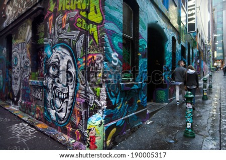 MELBOURNE, AUS - APR 10 2014:Visitors at Hosier Lane.Hosier lane is a much celebrated landmark in Melbourne mainly due to its sophisticated graffiti urban art. - stock photo
