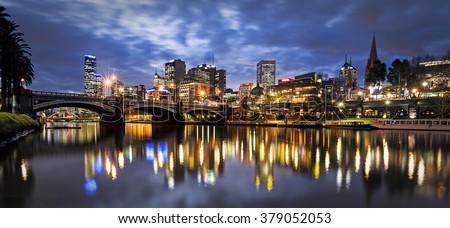 Melbourne, Australia, by night.  Yarra River and Princes Bridge. - stock photo