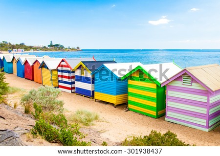 Melbourne, Australia - February 21, 2015: Brighton bathing boxes,  with classic Victorian architectural features, are a popular Bayside icon and cultural asset at Brighton Beach, Melbourne, Australia - stock photo