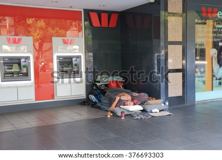 MELBOURNE AUSTRALIA - FEBRUARY 13, 2016: Unidentified people sleep on street in downtown Melbourne. Homelessness is an ongoing issue in Melbourne downtown area.  - stock photo