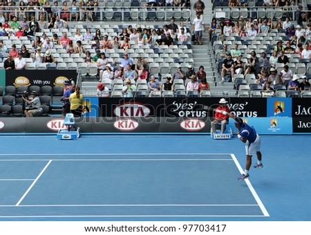MELBOURNE, AUSTRALIA - JANUARY 20: ATP tennis player Frederico Gil serves against Jo Wilfried Tsonga at Hisense Arena in the 2012 Australian Open, in Melbourne Australia on January 21, 2012. - stock photo
