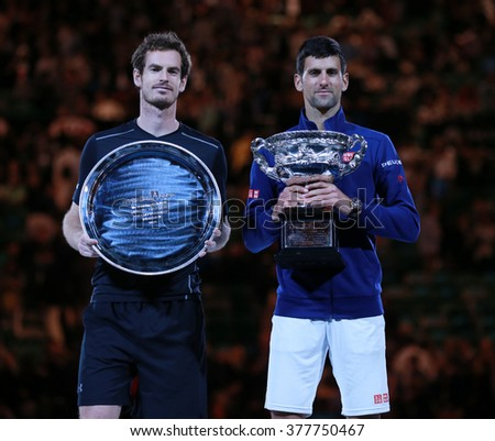 MELBOURNE, AUSTRALIA - JANUARY 31, 2016: Australian Open 2016 finalist Andy Murray (L) and Grand Slam champion Novak Djokovic of Serbia during trophy presentation after final match in Melbourne Park - stock photo