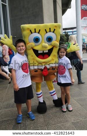 MELBOURNE, AUSTRALIA - JANUARY 23, 2016: Australian tennis fans taken pictures with SpongeBob SquarePants during Australian Open 2016 at Australian tennis center in Melbourne Park - stock photo