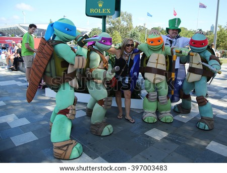 MELBOURNE, AUSTRALIA - JANUARY 23, 2016: Australian tennis fans taken pictures with Teenage Mutant Ninja Turtles during Australian Open 2016 at Australian tennis center in Melbourne Park - stock photo