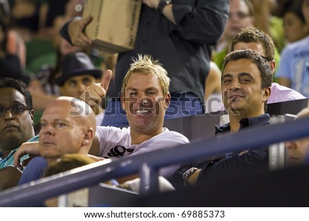 MELBOURNE, AUSTRALIA - JANUARY 22: Cricket Legend Shane Warne & Friend Joe Hachem at the Rod Laver Arena which holds the center court at the Australian Open, January 22, 2011 in Melbourne, Australia - stock photo