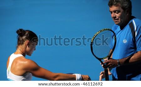 MELBOURNE, AUSTRALIA - JANUARY 16: Dinara Safina (L) of Russia at a practice session ahead of the 2010 Australian Open at Melbourne Park on January 16, 2010 in Melbourne, Australia - stock photo