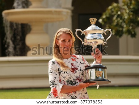 MELBOURNE, AUSTRALIA - JANUARY 31, 2016: Grand Slam champion Angelique Kerber of Germany posing in Government House with championship trophy after victory at Australian Open 2016 in Melbourne  - stock photo