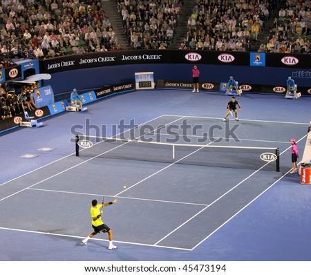 MELBOURNE, AUSTRALIA - JANUARY 27: Jo-Wilfried Tsonga of France in his quarter final win over Novak Djokovic during the 2010 Australian Open on January 27, 2010 in Melbourne, Australia - stock photo