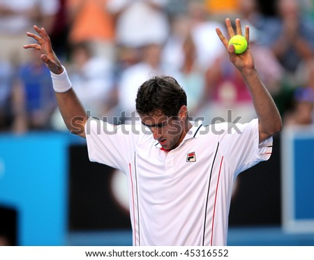 MELBOURNE, AUSTRALIA - JANUARY 26: Marin Cilic of Croatia celebrates his quarter final win over Andy Roddick during the 2010 Australian Open on January 26, 2010 in Melbourne, Australia - stock photo