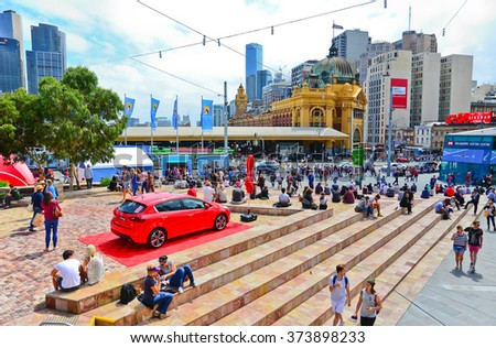 Melbourne, Australia - January 18 : People visiting Federation Square in Melbourne city cetre on January 18, 2015. The square is a public space created in 2002 in the heart of Melbourne.  - stock photo