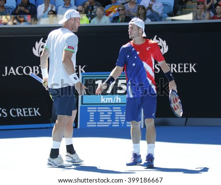 MELBOURNE, AUSTRALIA - JANUARY 24, 2016: Professional tennis player Sam Gross (L) and two times Grand Slam Champion Lleyton Hewitt of Australia in action during  doubles match at Australian Open 2016 - stock photo