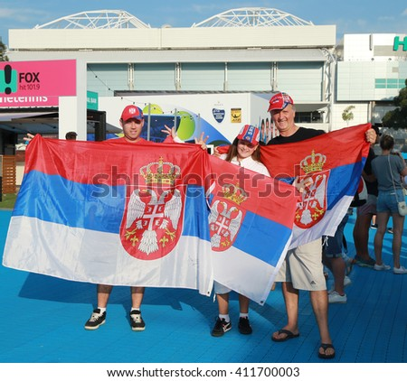 MELBOURNE, AUSTRALIA - JANUARY 29, 2016: Serbian tennis fans with flags at Australian Open 2016 at Australian tennis center in Melbourne Park - stock photo