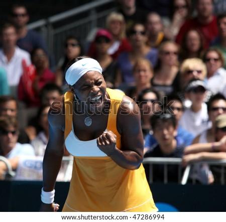 MELBOURNE, AUSTRALIA - JANUARY 23: Serena Williams celebrates a key point on her way to the 2010 Australian Open title.  January 23, 2010 in Melbourne, Australia - stock photo