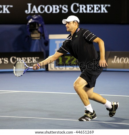 MELBOURNE, AUSTRALIA - JANUARY 17: US tennis player Andy Roddick during a charity tennis exhibition for the victims of the Haiti earthquake, in Melbourne Australia on January 17, 2010. - stock photo