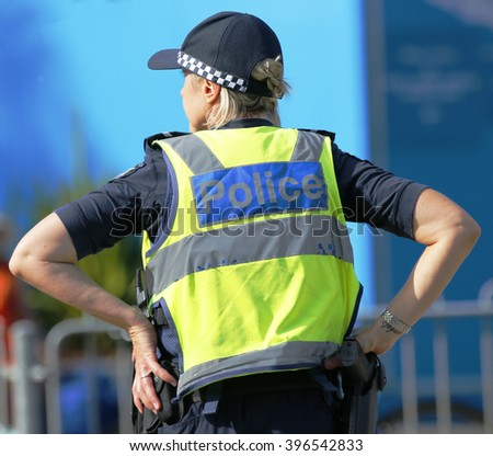 MELBOURNE, AUSTRALIA - JANUARY 23, 2016: Victoria Police Constable providing security at Olympic Park in Melbourne during Australian Open 2016 - stock photo