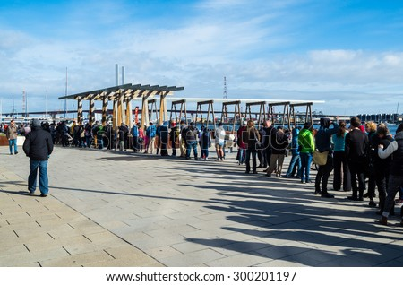 Melbourne, Australia - July 25, 2015: people queuing at Victoria Harbour, Docklands for a Port of Melbourne boat cruise at the annual Open House Melbourne event. - stock photo