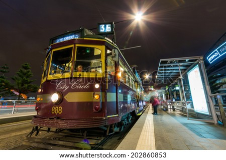 MELBOURNE, AUSTRALIA - JUNE 3, 2014: The City Circle (route 35) is a zero-fare tram running around the central business district of Melbourne, Australia.  - stock photo