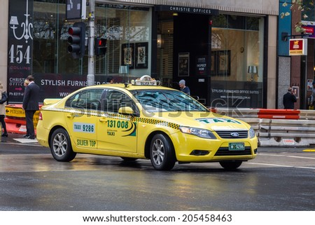 MELBOURNE, AUSTRALIA - JUNE 3, 2014: Yellow cabs in Melbourne, Australia. Taxis in Melbourne are regulated by the Taxi Services Commission which commenced that role on 1 July 2013. - stock photo