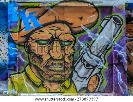 MELBOURNE, AUSTRALIA - MAR 19: Man Graffiti at Hosier Lane on Mar 19, 2015 in Melbourne. It's one of the tourist attraction which is the ever-changing graffiti on the walls of Hosier Lane. - stock photo