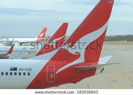 MELBOURNE AUSTRALIA - MARCH 14, 2014: Qantas airplanes wait for departure at Melbourne Airport - Melbourne Airport is the primary airport serving the city of Melbourne and hub for Qantas airlines  - stock photo