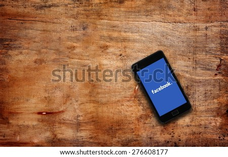 Melbourne,Australia-May 7,2015: Facebook page on the smartphone on table. Facebook is very well know social networking service founded in 2004 by Mark Zuckerberg - stock photo