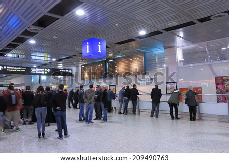 MELBOURNE AUSTRALIA - May 24, 2014: Unidentified people wait at Melbourne Airport arrival lobby - Melbourne Airport is the primary airport serving Melbourne and hub for Qantas airlines  - stock photo