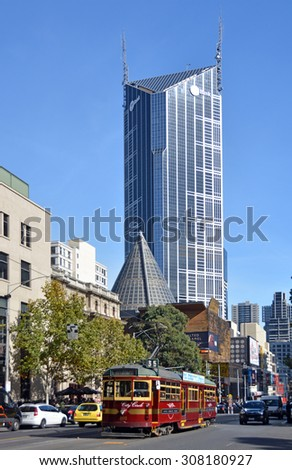 Melbourne, Australia - May 14, 2014: Vintage red tram in La Trobe street. In the background is the central tower and ME Bank Building - stock photo