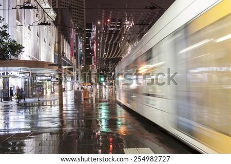 MELBOURNE, AUSTRALIA -NOV 22: Street view of Melbourne CBD at a rainy night on November 22, 2011, Melbourne, Australia.  - stock photo