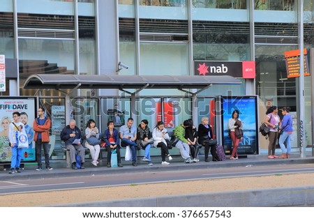 MELBOURNE AUSTRALIA - SEPTEMBER 19, 2015: Unidentified people wait at bus stop in Melbourne city centre. Bus is one of the key public transport in Melbourne.  - stock photo